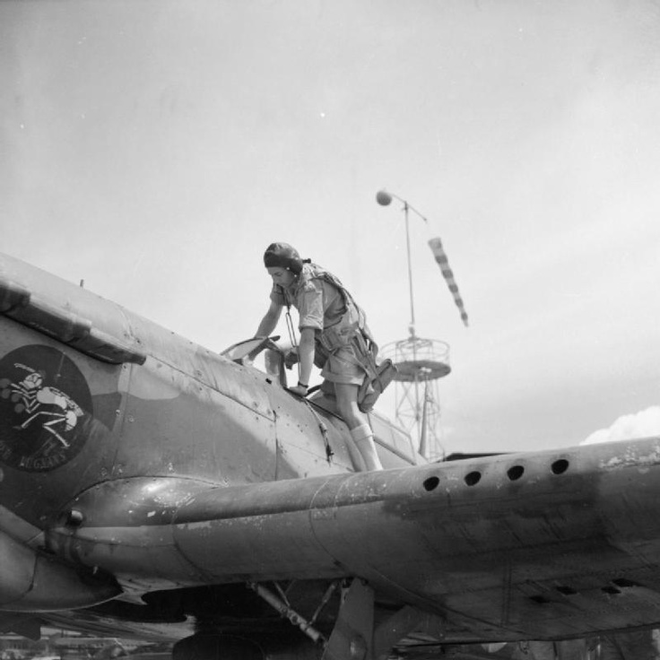 "Captain J E ""Jack"" Frost climbs into a Hawker Hurricane of No. 3 Squadron SAAF at Addis Ababa, after rejoining his unit as 'A' Flight commander following an attack of appendicitis. Jack Frost was the most successful fighter pilot in the SAAF. He was the SAAF's top scorer of the war with 16 confirmed victories and was regarded as an outstanding pilot and leader. Note 3 Squadron's unit emblem on the side of the nose."