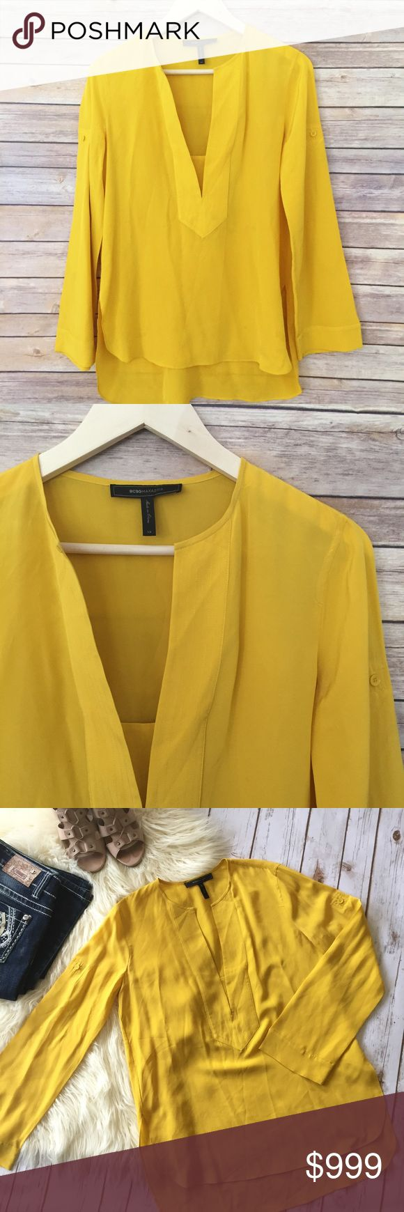 "BCBG yellow blouse with modest bust piece This is a great, bright blouse with modest piece of cloth across the chest, so it doesn't go too low. Great color for any season!  Measurements laying flat: fits more like a S/M, in my opinion. * Bust 19"" * Length 26"" * Arm 24""  Condition/Flaws * Gently used, but still in excellent condition * No significant flaws (stains, rips, pilling)  Item # * BCBGeneration Tops Blouses"