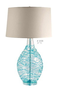 "Beautifully artisan created 31""h glass lamps with threads of sea aqua blue glass wrapped around a 11""w clear bubble glass hand-blown base."