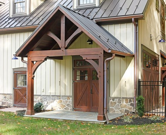 Barn 2.  Best design example of what we think might work want but doesn't show enough of porch.  We like the cupolas, the trim, the timber and the   Brown metal roof.  Beams,  white (want true white matching house).  What if we had the Split stone high way up on the wall.  We would like to price using split stone vs. Ga brick on lower half.  Hardy board up to metal roof.  Love detail. Combining Barn one with this one seems very close to what we want.