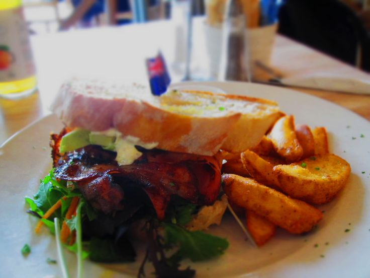 Eating some really good BLAT (Bacon, Lettuce, Avocado and Tomato) Sandwich with  some amazing wedges on the side. - The Golden Sands Cafe New Zealand