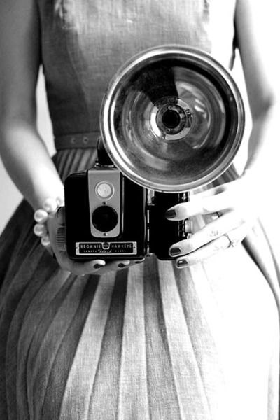 cameras as in the 50's when Jackie Kennedy Onassis worked for a newspaper