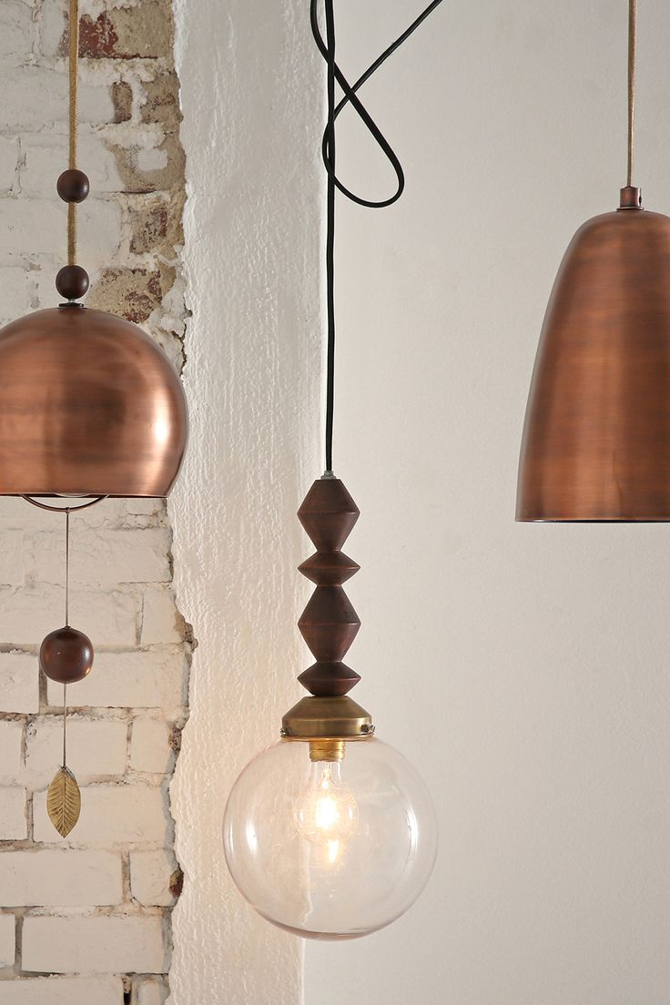 Copper lighting. The longest Brass pendant woud be perfect.