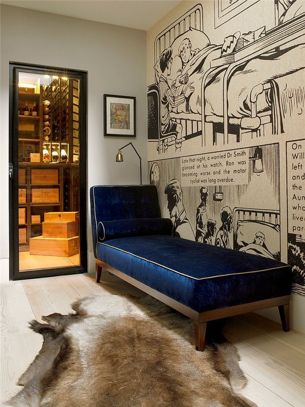 fun home office with comic strip accent wall over a blue velvet chaise lounge next to an adjustable floor lamp and glass door leading to wine roomover light