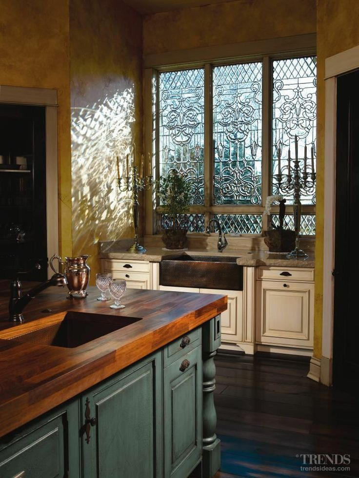 Love that copper farmhouse sink and those windows are breathtaking!!!