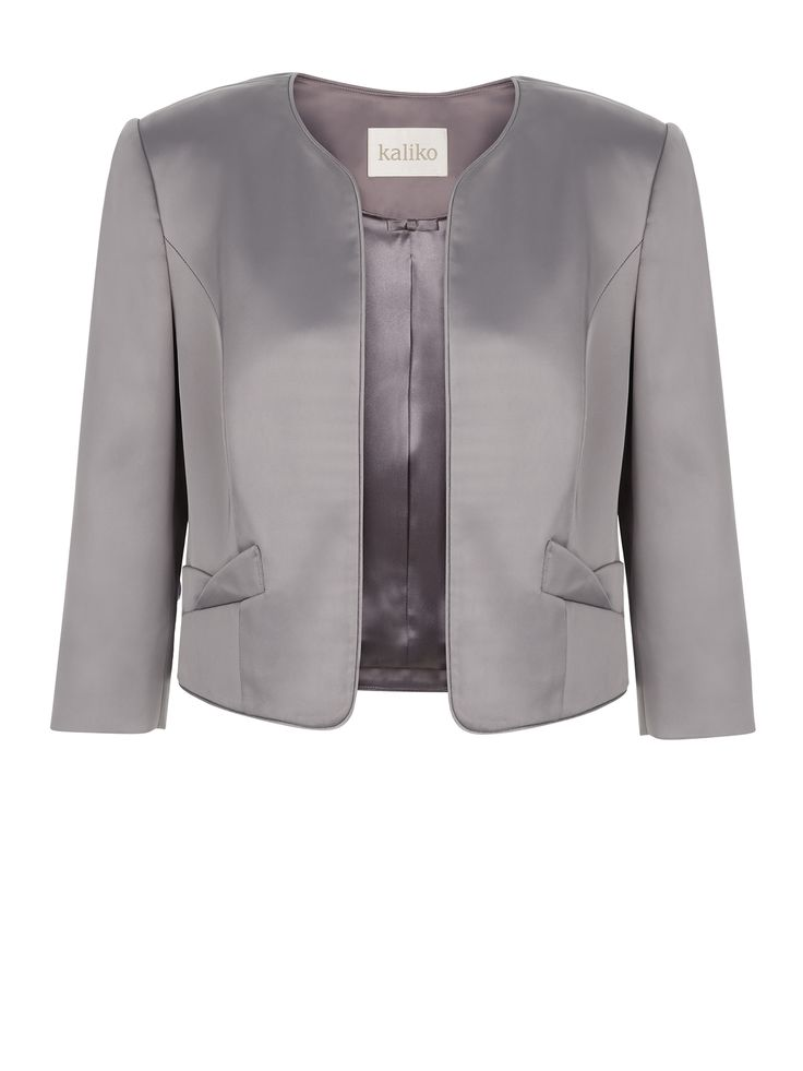 Now reduced to €79!! Oyster satin jacket with piping and bow detail pockets €169.