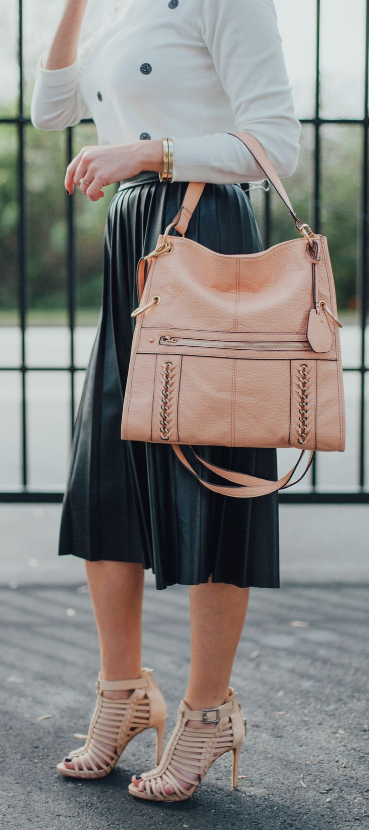 This Jessica Simpson foldover bag is the answer to all of your handbag problems! It's perfect for work or play, and can be worn a few different ways! Choose from 3 different colors - Black, Peach and Seafoam!