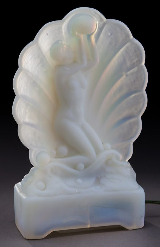 """French Art Deco opalescent glass figural lamp depicting female nude atop waves with surrounding shell, raised on footed base signed, """"Legrand Paris"""". Electrified. 10.5""""H x 6""""W, Circa - 1920's."""