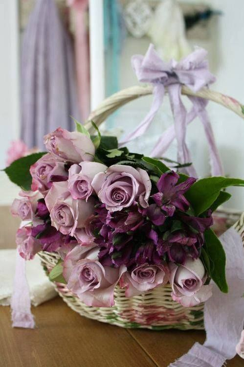 purple flowers in a basket and purple ribbon