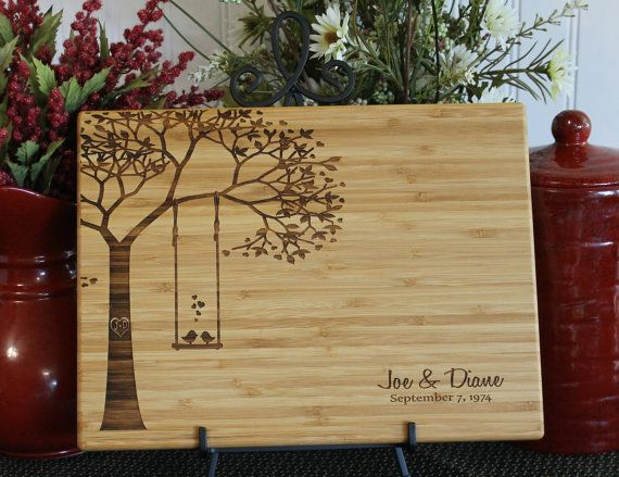 This personalized cutting board comes engraved with two love birds on a swing. It makes a special and unique gift for a wedding, anniversary,
