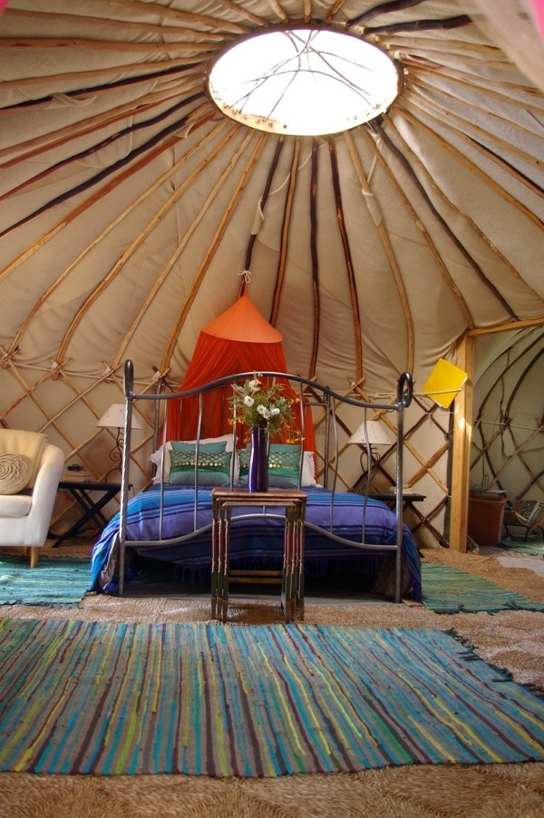 Go 'Glamping' - preferably in a Yurt, but a bell-tent or Tipi would be fine too :)