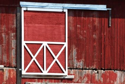 Flower bed ideas for the front of a house facing east for Hanging barn door in house