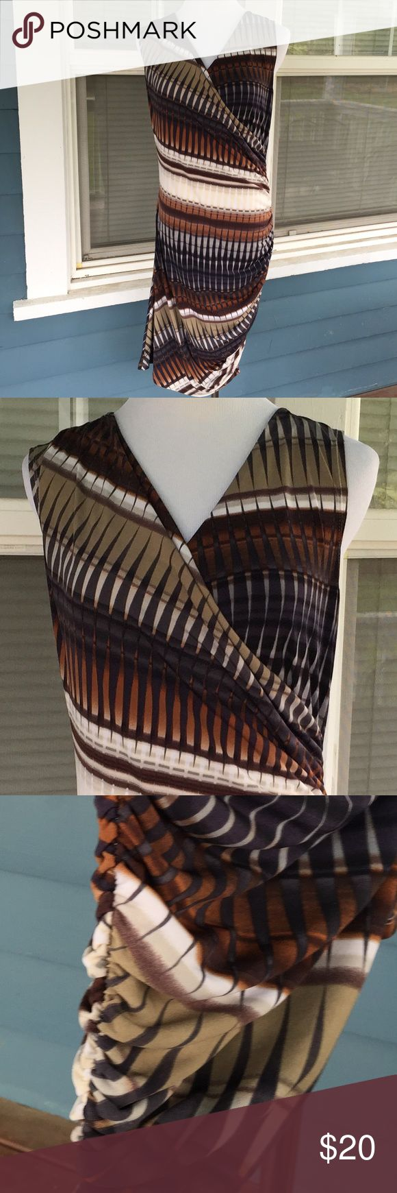 """SOFIA VERGARA Body Con Dress SOFIA VERGARA Body Con Dress.   VNeck.   Drapy front.  Sleeveless.   Gathered left side skirt.  Brown/tan/beige patterned polyester/spandex blend stretchy material.   Pit-to-pit  20"""".   Length 40"""" (shoulder to left side hem),   Excellent condition. Sofia Vergara Dresses"""