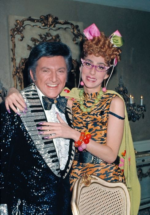 Cher & Liberace -- of the Sony and Cher fame. Liberace (he was often referred to as Lee) wears another of his numerous custom-made costumes - this one probably made especially for the Sony and Cher tv show.
