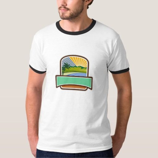 Tropical Trees Mountains Sea Coast Crest Retro T-shirt. Illustration of tropical trees, mountains and sea coast set inside shield crest with sunburst in the background done in retro style. #Illustration #TropicalTreesMountainsSea