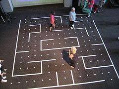 Youth Group Game- Life Size Pac-Man  Grab some tape and make a Pac-Man board on your floor. Put down coins for the dots. Have a couple of friends throw on sheets to make the ghosts. Have another friend try to collect all the coins while the ghosts try to catch them!