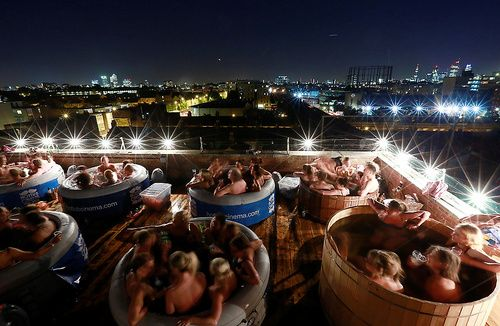 'Hot Tub Cinema' event,roof of a warehouse in Hackney, east London Movie lovers sit in hot tubs and watch films at a 'Hot Tub Cinema&...