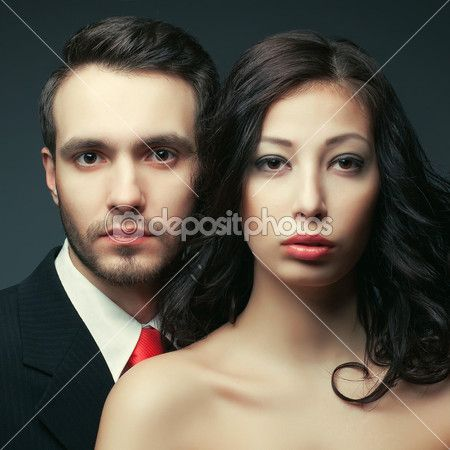 Intelligent couple concept. Portrait of a sexy elegant couple in — Stock Image #45559585