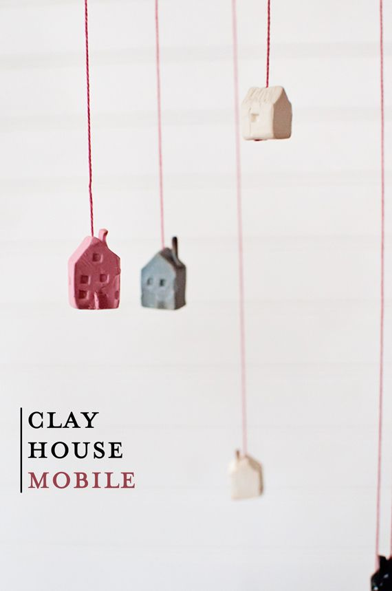 Sooo adorable! A tiny clay house mobile.