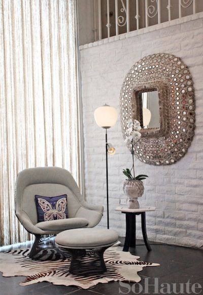 Hotel Parker vis So Haute  White brick walls with a blinged vintage mirror