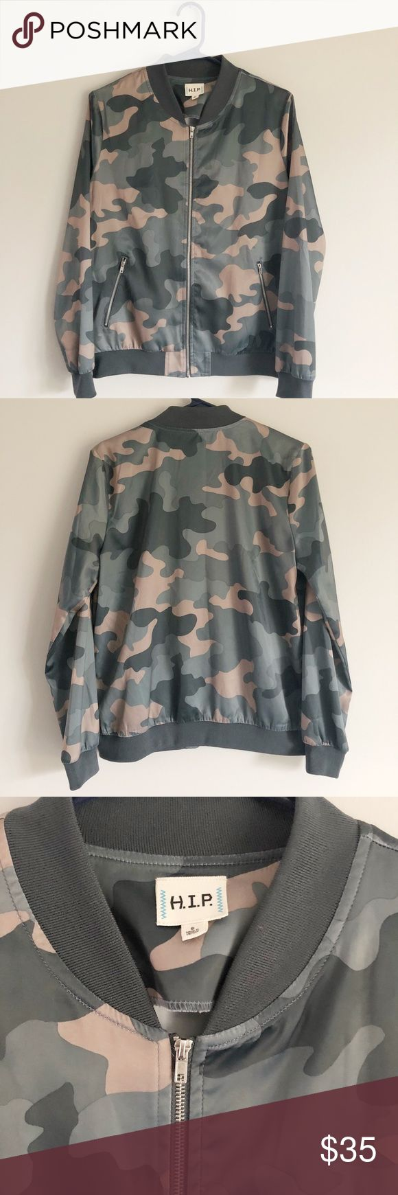 """H.I.P. Camo Bomber Jacket H.I.P. Camo Bomber Jacket with zip front. Great condition, small snag and wear on right cuff but otherwise in excellent, like new condition. Originally purchased at Nordstrom.  Fabric Content: 97% Polyester 3% Spandex Length: 24"""" Width: 19"""" Sleeve Length: 23.5"""" H.I.P. Jackets & Coats"""