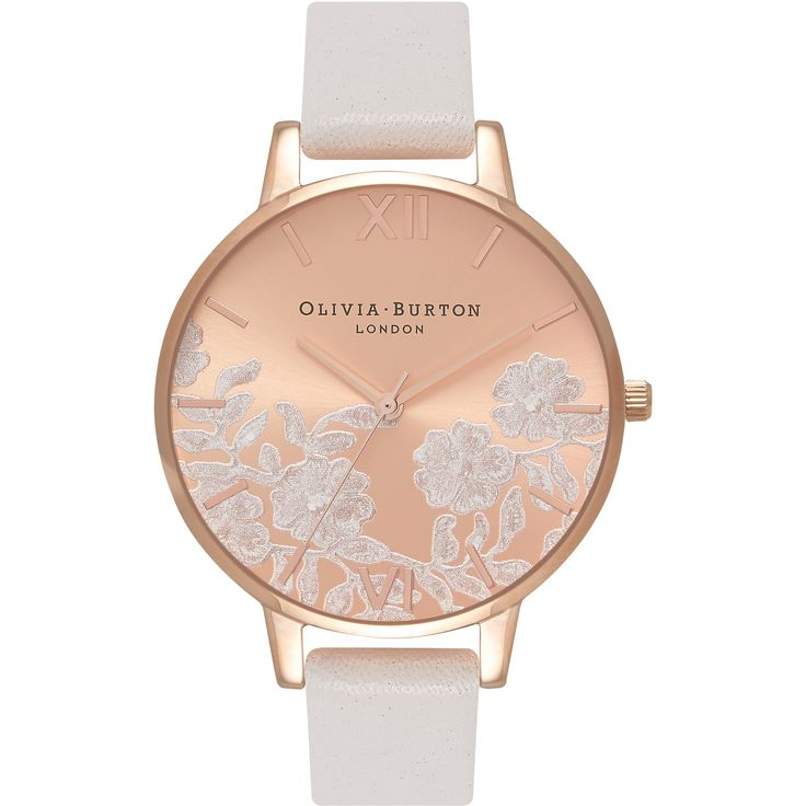 This  Olivia Burton Modern Vintage watch has a PVD rose plating case and is powered by a quartz movement. It fastens a white leather  strap and has a rose dial.
