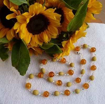 Did you know you can turn flowers into beads?  These beautiful beads were made from a bouquet of sunflowers, and strung with crystal and amber.  Check it out!