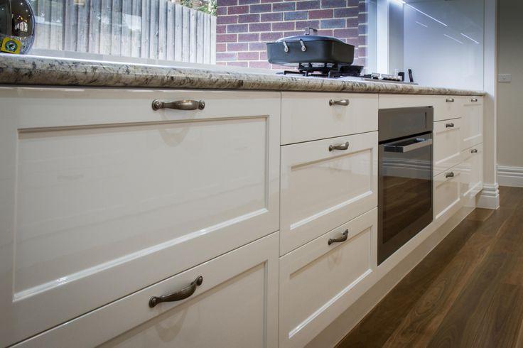 Traditional style kitchen. Window splashback. www.thekitchendesigncentre.com.au