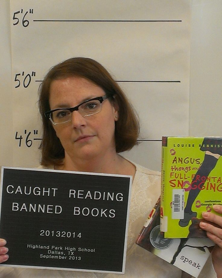 Book Scandal: Librarian Abby got her mug shot taken because she was caught reading Banned Books! We love it! Abby works at Highland Park HS in Dallas, TX. Email us a picture of you reading a Banned Book, we'll post it and enter you to win a tote filled with banned books.