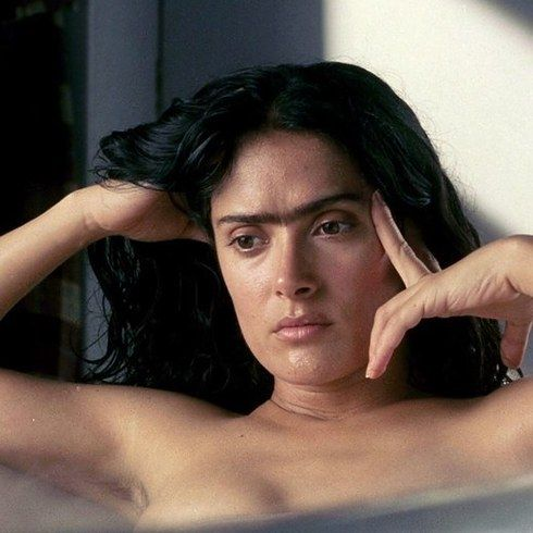 Salma Hayek as Frida Kahlo in Frida | 23 Incredible Photos Of Actors Vs. The Historical Figures They Played