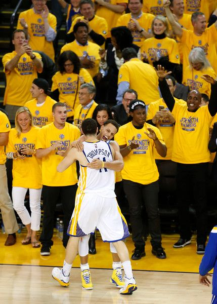 Description of . Golden State Warriors\' Stephen Curry (30) celebrates with Golden State Warriors\' Klay Thompson (11) after their 99-98 win against the Houston Rockets for Game 2 of theNBAWesternConferencefinalsat Oracle Arena in Oakland, Calif., on Thursday, May 21, 2015.  Former San Francisco Giants\' Barry Bonds can bee seen at right.  (Nhat V. Meyer/Bay Area News Group)
