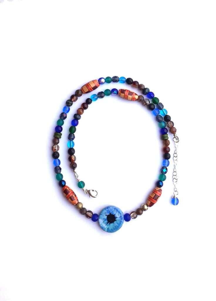 Now selling: Blue Eye Necklace with Hand Painted Blue Eye, Good Luck Charm, Beaded Talisman Necklace, Evil Eye Necklace https://www.etsy.com/listing/294110565/blue-eye-necklace-with-hand-painted-blue?utm_campaign=crowdfire&utm_content=crowdfire&utm_medium=social&utm_source=pinterest