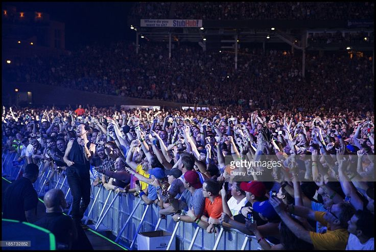 Pearl Jam is photographed in concert at Wrigley Field on July 25, 2013 in Chicago, Illinois.