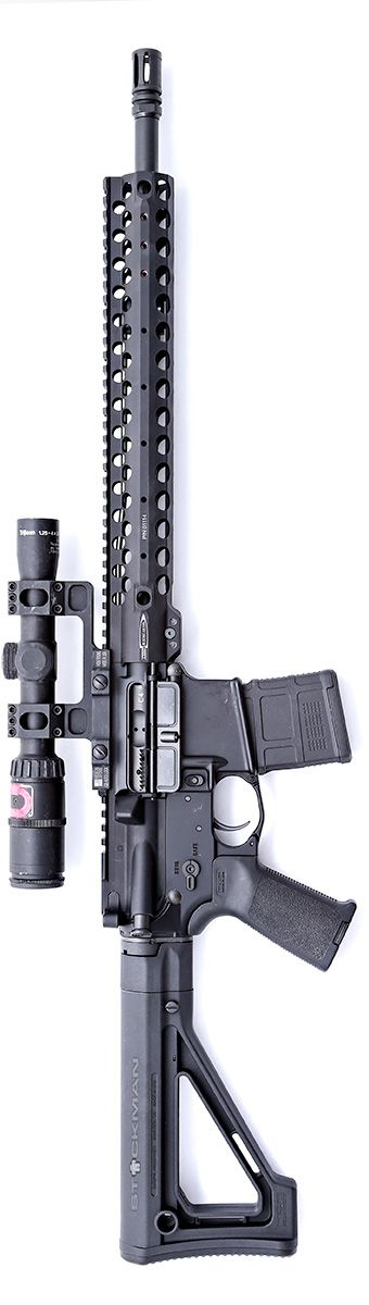 Magpul Fixed Carbine Stock with Centurion Arms complete upper receiver group and CMR rail. The optic is an older Trijicon, Inc. Accupoint. By Stickman.