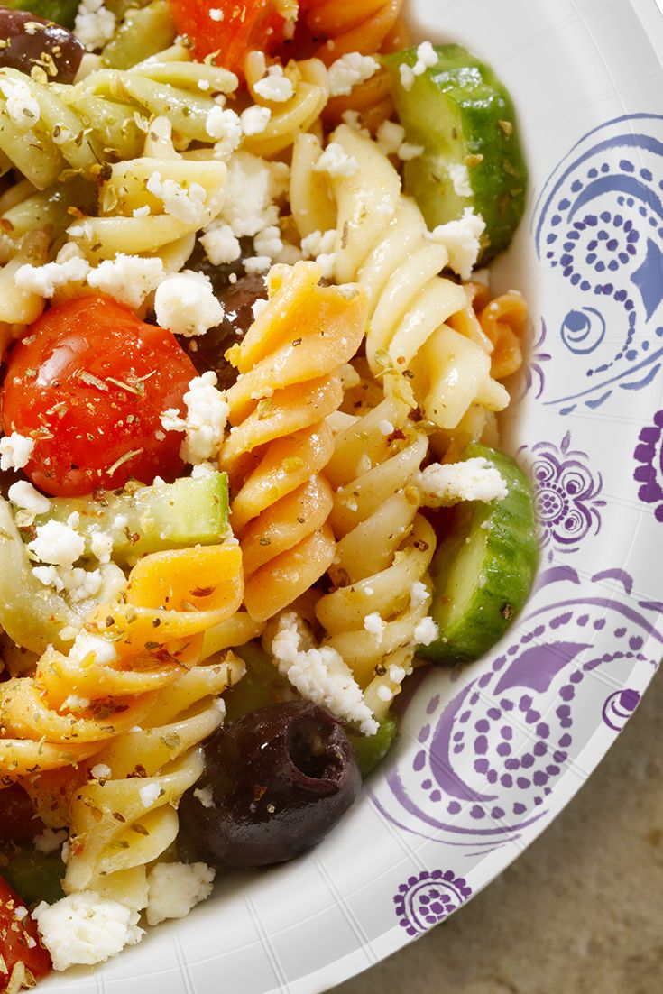 This easy Greek Pasta Salad recipe is a great way to enjoy an alternative to the stereotypical BBQ food this summer season. This pasta salad is packed with protein and flavors that even your meat-eating friends are sure to love. #BeMoreHere