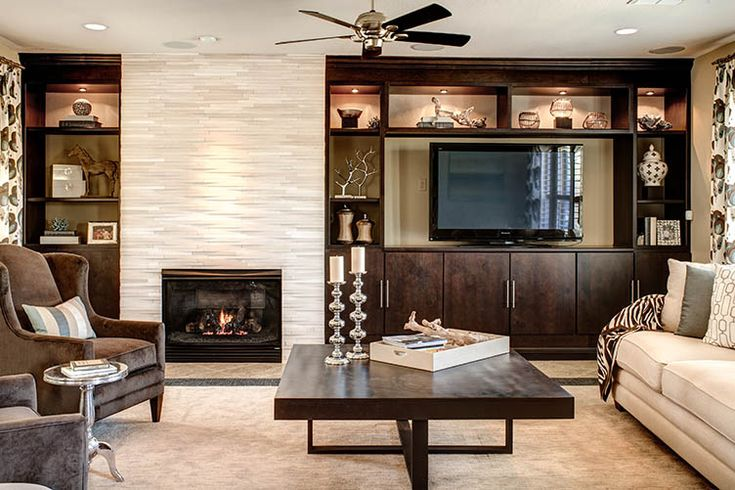 Warm and modern living space with fireplace and built in for House plans with fireplace in center of house