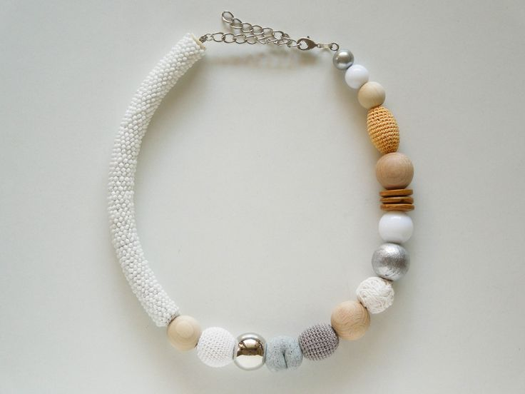 White asymmetric necklace with crocheted seed beads and other big handmade beads. #ivadidit