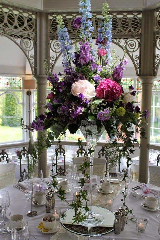Tall Elegant Martini Vase Designs With Fabulous Delphiniums Towering Over The Alliums Peonies Roses