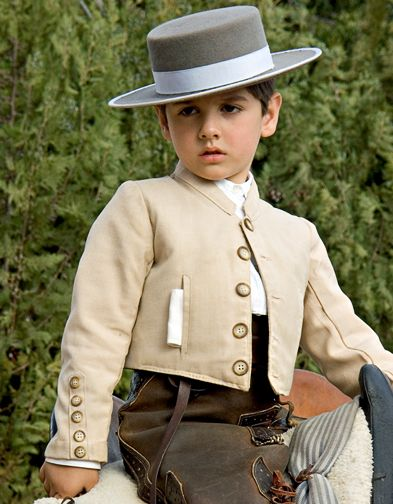 Teeny short waisted jacket with buttons, in linen! Eeee, for warmer formal occasions. Child of Spain--luminous-landscape.com