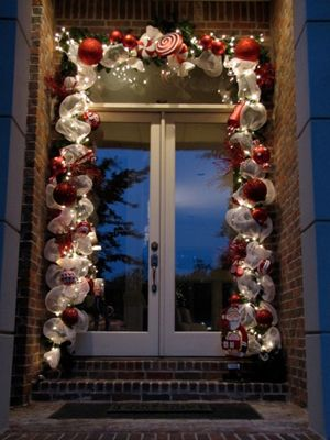 Christmas lights and ribbon on the front door....maybe on the inside of the house though?
