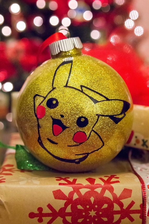 Hand made glass ornament, 4 inches in diameter. Gorgeous gold glitter on the inside prevents glitter shedding. This ornament features a high quality permanent vinyl Pikachu.   Please note: All items are made in a smoke free, pet friendly home.