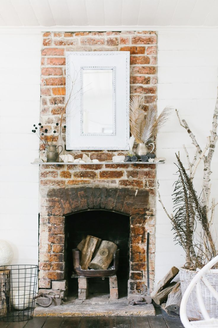 exposed brick fireplace | interior design + decorating ideas