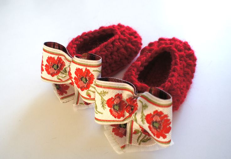 Handmade crochet shoes for a just born baby girl. Made of bulky hot 100% wool - in real deep red color - decorated with handmade bow made of flowered ribbon. Which flower? - One of the most beautiful - a poppy flower.