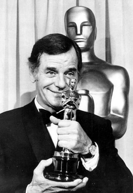 "Gig Young with the best supporting actor Oscar he won for ""They Shoot Horses, Don't They?"", 1969"