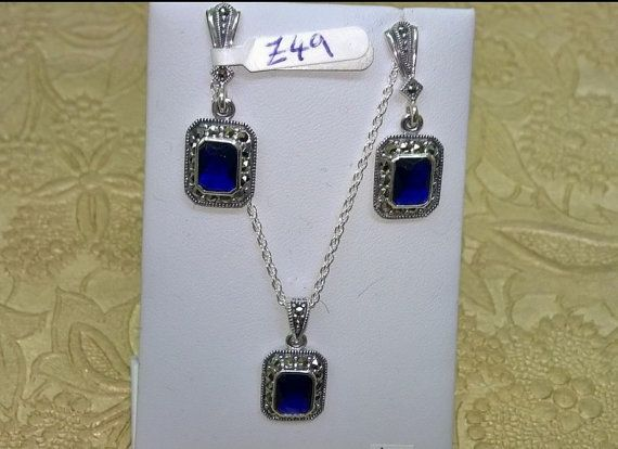 A new pair of sterling silver earrings set with cubic zirconia in sapphire blue colour decorated with sparkling marcasites. Hallmarked 925. They measure 3cm drop by 1.1cm wide.  Matching pendant available in a separate listing.  International shipping takes about 1 week.