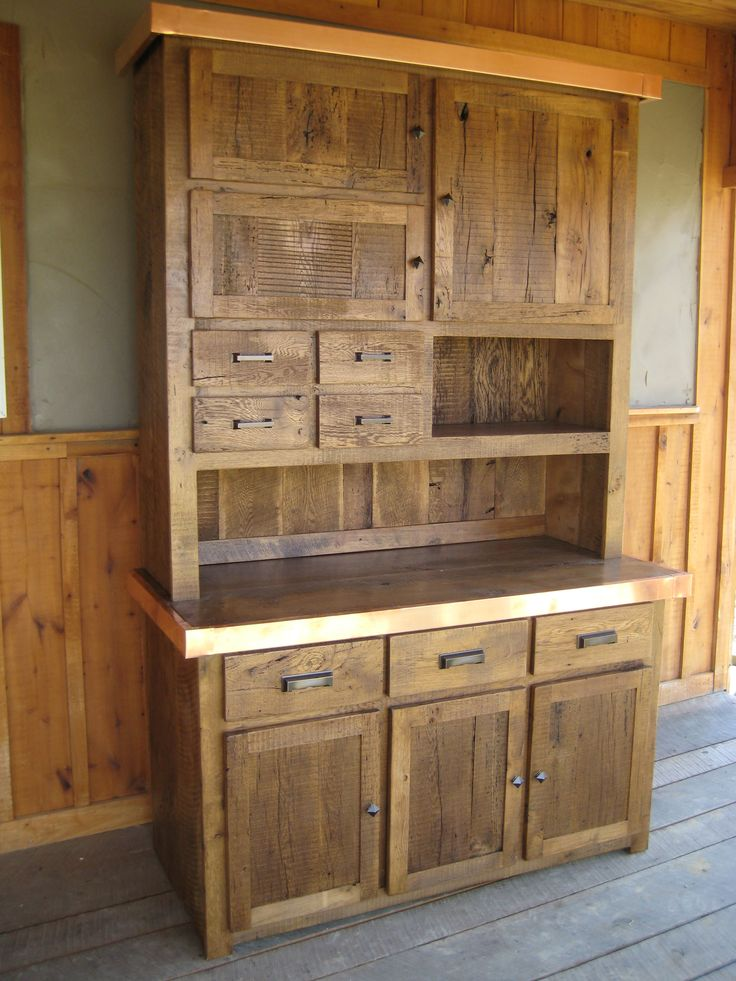 100-150 Year Old Reclaimed Wormy Chestnut Step Back Cupboard with Copper Trim Edging.