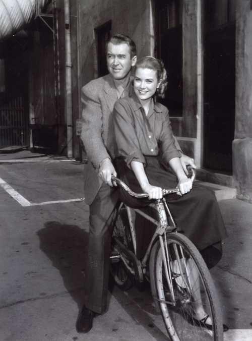 James Stewart and Grace Kelly ride a bike