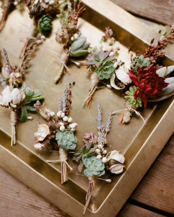Boutonnieres that feature lush greenery and fragrant blooms are perfect for an outdoor wedding. These are made of cotton blooms, succulents, and lavender.
