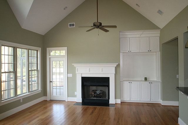 Grayish green living room. love the contrast with the white trim