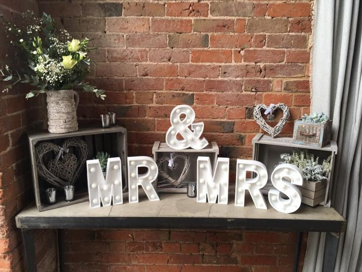 Entrance table set up at shustoke farm barns, including #props #vinatagebooks #hearts #flowers #crates #lanterns #candles #jarsflowers #jugsflowers #guestsignbook #postbox #shustokefarmbarns #pennyjohnsonflowers #warwickshireflorist #birminghamflorist #warwickshirevenue #barnwedding #mr&mrssign